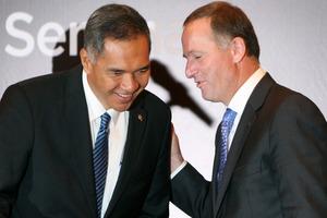 New Zealand's Prime Minister John Key, right, talks with Indonesian Minister of Trade Gita Wiryawan. Photo / AP