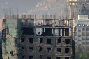 Afghan special forces are seen on top of a building which was occupied by militants in Kabul. Photo / AP