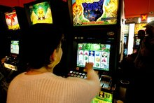 Pokie machine may come with risks. Photo / Martin Sykes