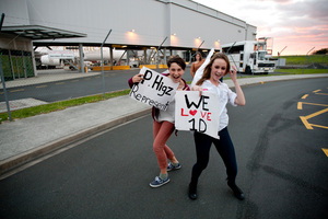 One Direction fans run around Auckland International Airport hopeful for the chance to see One Direction as they fly in from Australia. Photo / Dean Purcell
