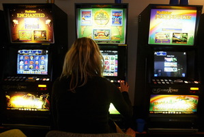 SkyCity wants to install 350-500 more poker machines as part of a deal to build a $350 million convention centre next to the casino. Photo / APN