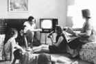A family watching television in the lounge of their home. 1962 file photo / New Zealand Herald