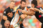 Aaron Woods of the Tigers is tackled during the round seven NRL match between the Penrith Panthers and the Wests Tigers. Photo / Getty Images.