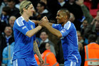 Chelsea's Florent Malouda, right, is congratulated by team mate Fernando Torres after scoring a goal against Tottenham Hotspur. Photo / AP