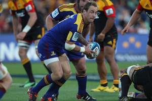 Jimmy Cowan of the Highlanders looks to pass. Photo / Getty Images.