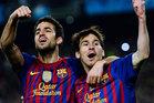 Cesc Fabregas and Lionel Messi. Photo / AP