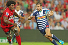 Peter Grant of the Stormers makes a break past Radike Samo of the Reds. Photo / Getty Images