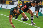 Greg Inglis of the Kangaroos scores a try in the corner. Photo / Getty Images