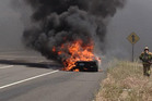 A black Lamborghini Aventador LP700-4 goes up in smoke on a Californian highway. Photo / John Evans Facebook