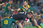 Shaun Kenny-Dowall of the Kiwi's is tackled by Paul Gallen and Cameron Smith of the Kangaroos. Photo / Getty Images
