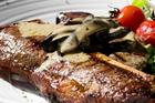 T-Bone steak with mushroom sauce. Photo / Richard Robinson