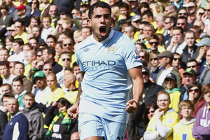 Manchester City's Carlos Tevez celebrates after scoring their third goal against Norwich City during their English Premier League match at Carrow Road. Photo / AP