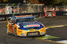 Will Davison is chased by Garth Tander in the V8 Supercar series yesterday.