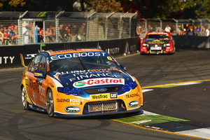 Will Davison is chased by Garth Tander in the V8 Supercar series yesterday. Photo / Getty Images