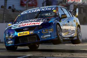 Mark Winterbottom gets some air during his winning race on the Hamilton street circuit yesterday.  Photo / Christine Cornege