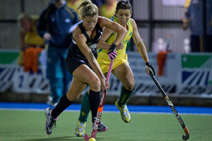 Black Stick Gemma Flynn (left) fights for possession in last night's match against Australia. Picture / Sarah Ivey