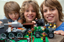 Brothers (from left) Jesse Swift, 8, Beau, 10, and Jarrah, 12, use Lego to re-enact the World War II battle of Crete.  Photo / Brett Phibbs