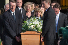 Alastair Haigh (right), son of the late John Haigh QC, carries his father's casket as it is piped from the Holy Trinity Cathedral. Photo / NZ Herald