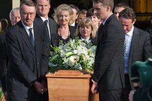 Son Alastair Haigh (right) and Paul East, QC, lead pallbearers carrying John Haigh's casket. Photo / Greg Bowker