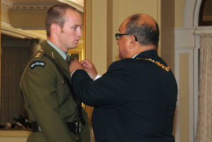 Former Governor-General Anand Satyanand presents Tim O'Donnell with the Distinguished Service Decoration for services to the NZDF. File Photo / Supplied