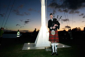 A lone piper heralds the dawn at Waitangi. Photo / Doug Sherring