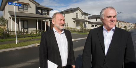 David Halsey (left), and Evan Davies look over completed houses at the Stonefields site. Photo / Paul Estcourt