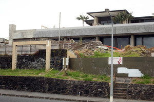 The unfinished house with seafront Paritai Drive frontage remains unsold. Photo / Janna Dixon