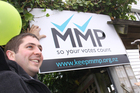 Oliver Christeller (left), holds up an MMP supporters sign outside his flat on Nairn St, Wellington, with Wellington mayor Celia Wade-Brown. Photo / APN