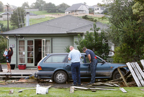 A fleeing driver smashed through a fence of an Otangarei home. Photo / Michael Cunningham