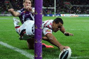 Bill Tupou scores a try for the Warriors against the Storm. Photo / Getty Images.