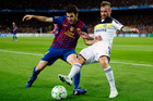 FC Barcelona's Cesc Fabregas, (left), duels for the ball against Chelsea's Raul Meireles during their teams' semifinal Champions League soccer match at the Camp Nou stadium in Barcelona, Spain. Photo / AP