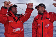 Tony Rae and Stu Bannatyne have a chat on deck onboard CAMPER with Emirates Team New Zealand. Photo / Hamish Hooper