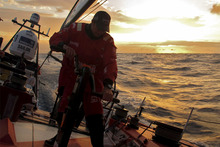 Andy McLean grinding at sunset on the first day, onboard CAMPER with Emirates Team New Zealand during leg 6 of the Volvo Ocean Race. Photo / Hamish Hooper