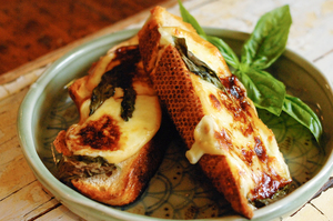 Smoked mozzarella, balsamic and basil grilled toasted sandwich. Photo / Jason Dorday