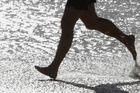 Running barefoot is an effective way to improve running technique and reduce injury says trainer, James Kuegler. Photo / Thinkstock