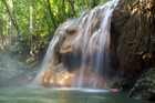 The Finca el Paraiso Falls near Rio Dulce are fed by a hot spring, providing wonderful pummelling massages for those who swim to its base. Photo / Thinkstock