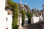 Distinctive trulli houses line a street in Alberobello, Puglia. Photo / Thinkstock