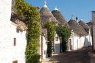 Distinctive trulli houses line a street in Alberobello, Puglia. Photo / Thinkstock