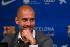Barcelona's coach Pep Guardiola smiles during a press conference where he announced his resignation in Barcelona, Spain. Photo / AP