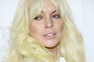 Lindsay Lohan's attitude on the set of Glee has been slammed, but a rep says she was working hard. Photo / AP