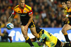 Sonny Bill Williams of the Chiefs is tackled by Victor Vito of the Hurricanes during the round 10 Super Rugby match between the Chiefs and the Hurricanes at Waikato Stadium. Photo / Getty Images.
