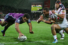 Justin O'Neill of the Storm scores a try during the round eight NRL match between the Melbourne Storm and the New Zealand Warriors. Photo / Getty Images.