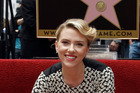 Actress Scarlett Johansson poses for photographers after receiving a star on the Hollywood Walk of Fame in Los Angeles. Photo / AP