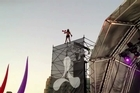 A man is believed to have walked away unscathed after falling 20 metres from scaffolding at a music festival in Sydney on Saturday. The man climbed the scaffolding tower alongside the main stage at the Creamfields music festival and danced while balanced precariously at the top, before tumbling dramatically back down again. Music website Musicfeeds.co.au reported St John is yet to confirm if they treated the man for injuries, but festival goers report the man got back to his feet and gave the thumbs up after the fall. Video courtesy YouTube TROUBLE787