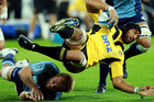 Victor Vito of the Hurricanes is tackled during the round 11 Super Rugby match between the Hurricanes and the Blues at Westpac Stadium. Photo / Getty Images.