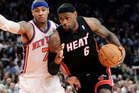 Miami Heat forward LeBron James (6) drives past New York Knicks forward Carmelo Anthony (7). Photo / Getty Images.