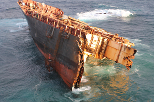 Only the bow section of the Rena remains above water seven months after the ship grounded. Photo / Maritime New Zealand