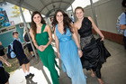 Lena Kemp (in green) Nicole Kruger (blue) and Karlien Burger model last year's outfits. Photo / Michael Craig
