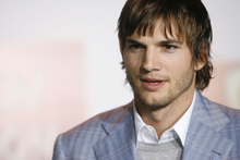 Ashton Kutcher has teamed up with snack food company Popchips for a series of fake dating service adverts. Photo / AP