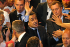 France's President and Candidate for re-election in 2012, Nicolas Sarkozy, waves to supporters after he delivered his speech during a campaign meeting, in Toulon, southern France. Photo / AP
